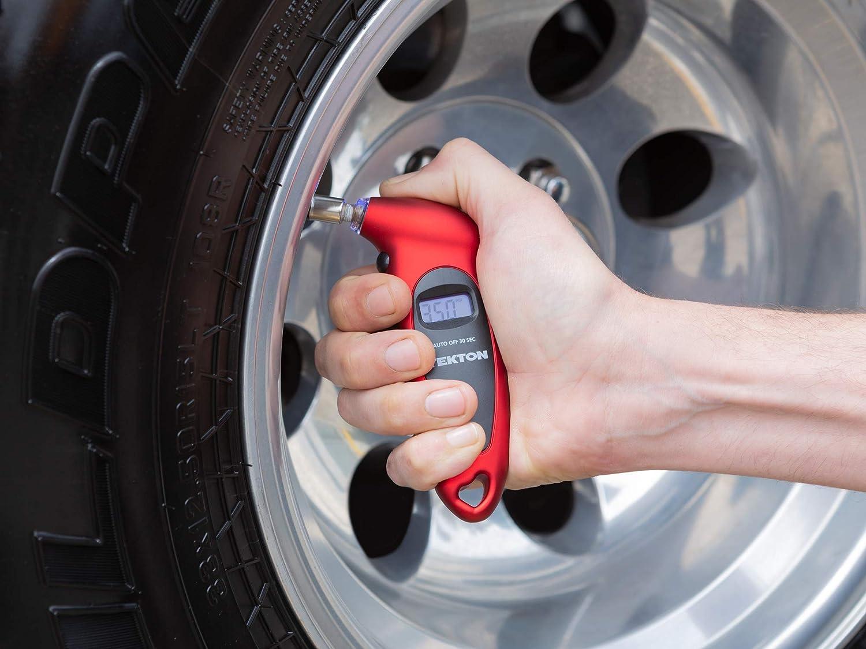 digital tire gauge measuring tire pressure