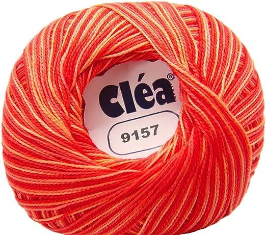 Ovillo grande de hilo de algodon color rojo naranja matizado. Para ...