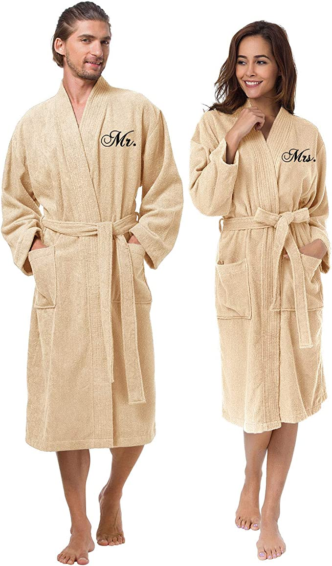 Image of a couple wearing couple robes with embroidery in beige