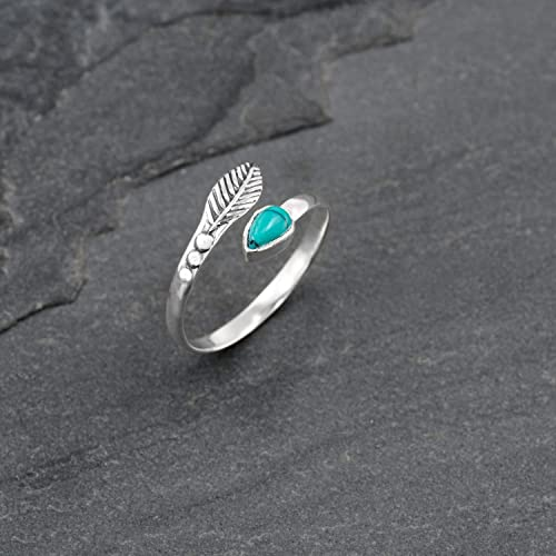 Toe ring or knuckle brass and turquoise.