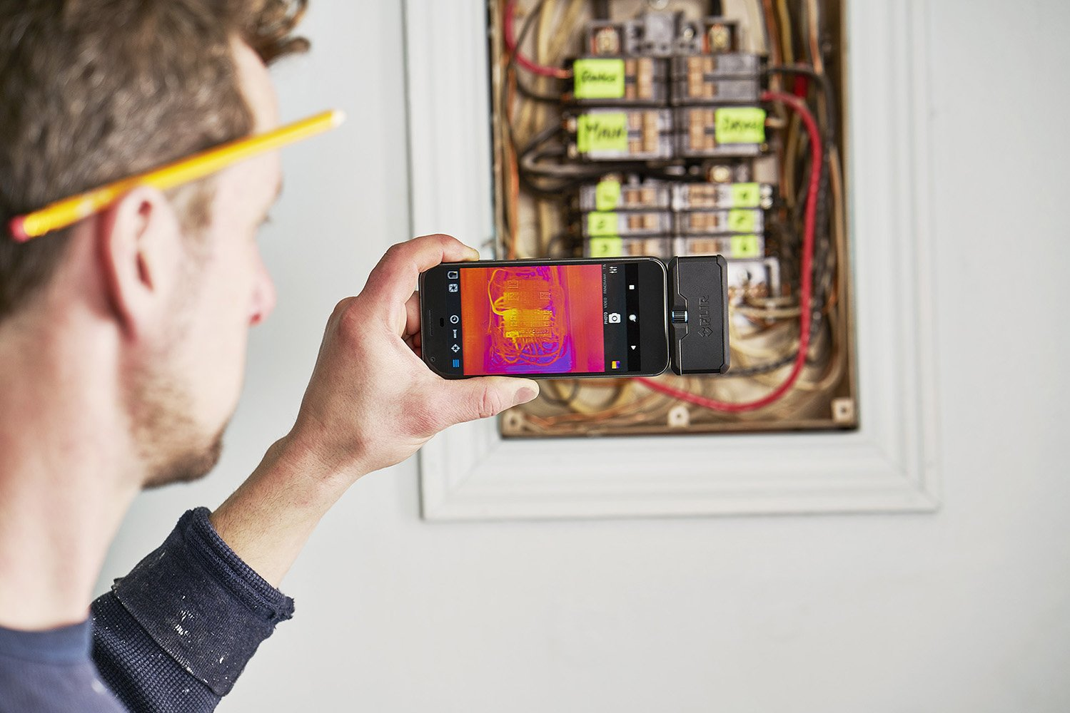 image of electrician using flir one