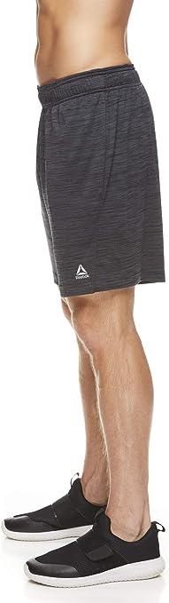 Reebok Pantalones cortos ligeros para hombre gimnasio y correr con cord/ón el/ástico en la cintura y bolsillos entrepierna de 22,8 cm para entrenamiento