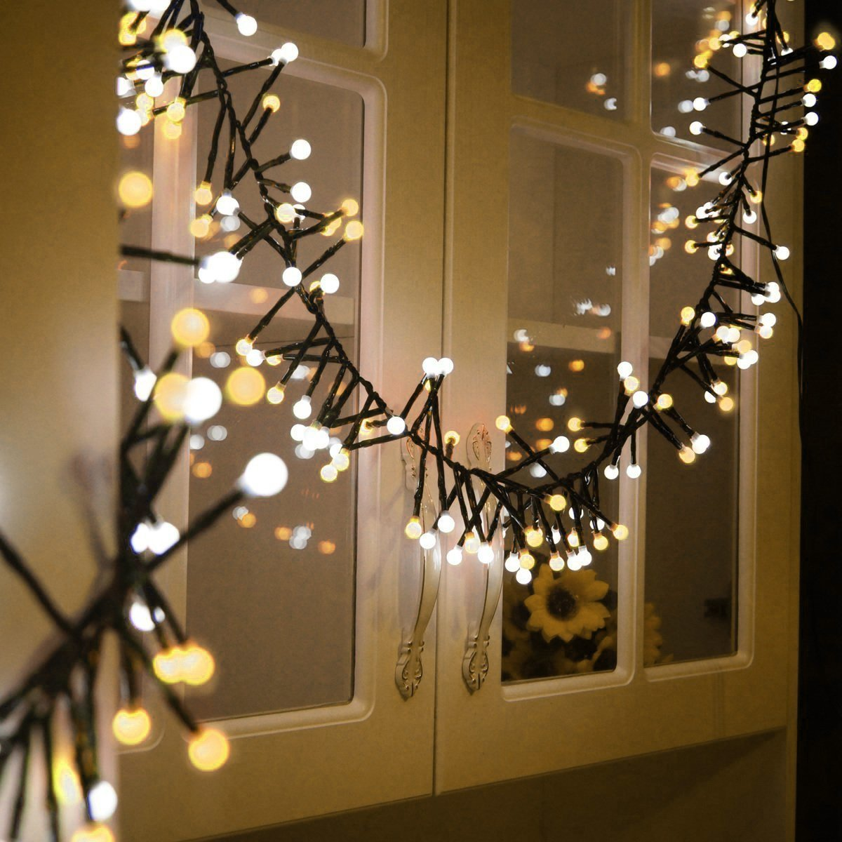 Quntis Christmas Fairy Lights Pretty LED Decorations String Lights Waterproof Starry Curtain Lights for Room Bedroom Outdoor Garden Window Party Home Indoor Backyard and Patio(Warm White)