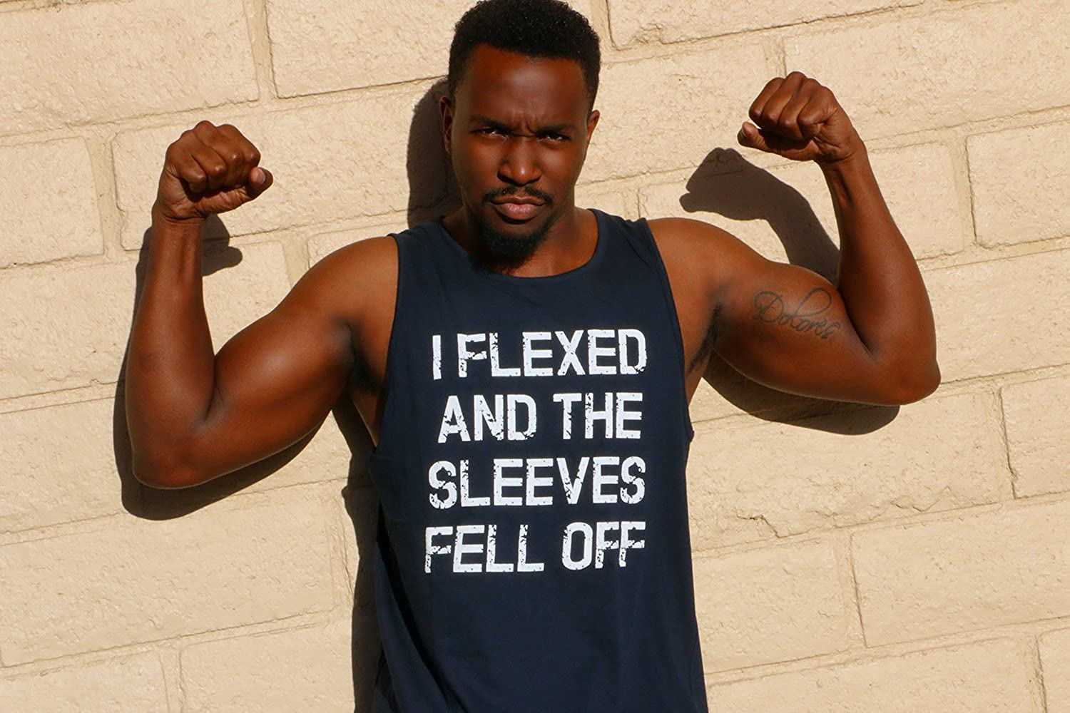 cf455f1a2a1da Amazon.com  Mens I Flexed and The Sleeves Fell Off Tank Top Funny  Sleeveless Gym Workout Shirt  Clothing
