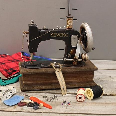 Diseño de estilo antiguo para máquina de coser con joyero con figura de caja de costura