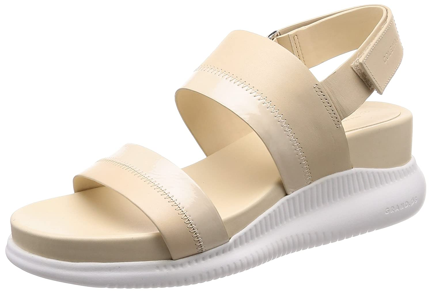 Cole Haan Women's 2.Zerogrand Slide Sport Sandal, Black Leather B079Q7XV5V 9 B(M) US|Brazilian Sand-optic White