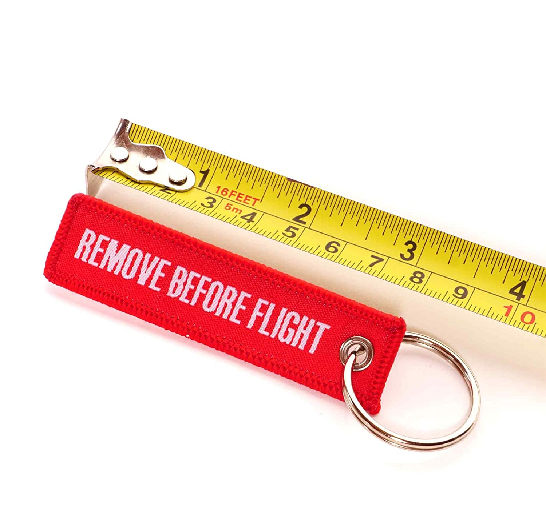 REMOVE BEFORE FLIGHT /® Lot de 2/mini porte-cl/és /• blanches et rouges /• Inscription /• Hand Format festif /• env 7,5/x 2,0/cm /• Original EU Marque /• de distributeur