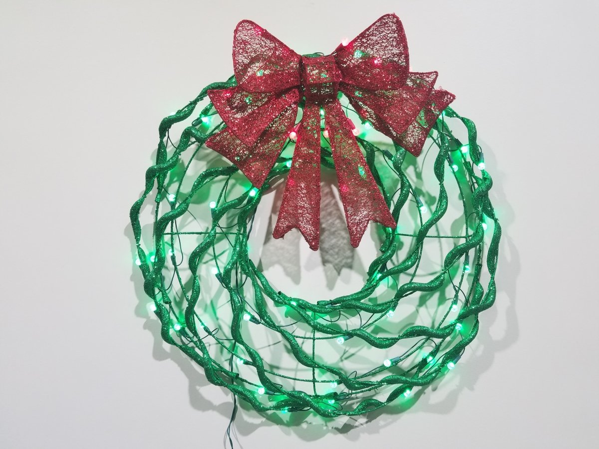 Puleo 42 in. Christmas Plastic Tubed Lighted Wreath with Glitter Bow