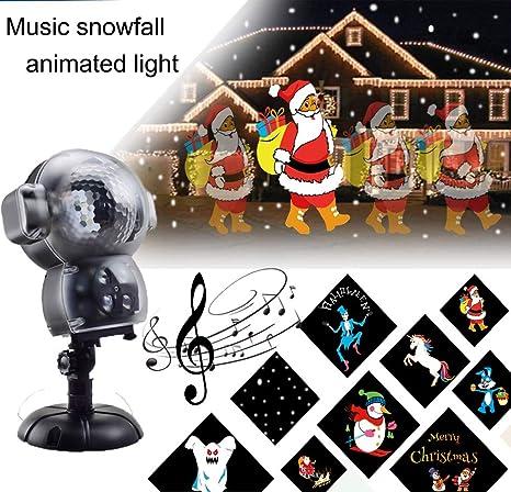 Proiettore Luci Di Natale Amazon.Basdt Proiettore Animato Luci Led Natalizie 8 Effetti Di Animazione Lettore Musicale Effetto Neve Caduta Telecomando Anime Natale Proiettore Luci