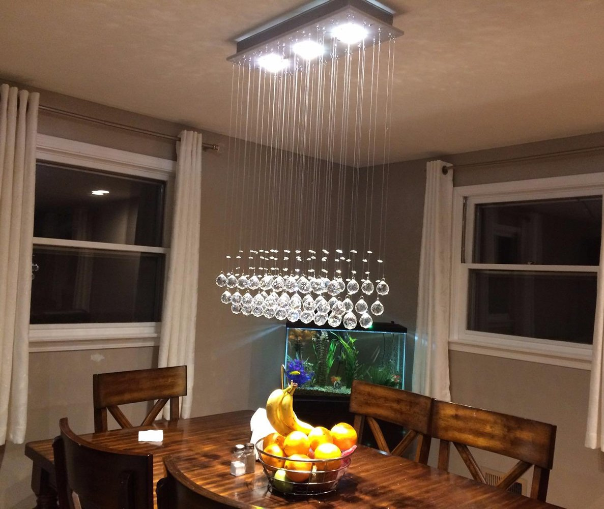 "7PM Modern K9 Crystal Chandelier Raindrop LED Ceiling Light Flush Mount Lighting for Dining Room L25'' x H39'' - Modern Chandelier: The variously sized crystals in this striking chandelier create a shimmering effect when the lights hit them just right, displaying a refracted rainbow. Hang in your glamorous dining room to up the elegance in your modern home. High-Quality Materials: Polished chrome stainless steel canopy, top K9 clear crystal. Fixture Size: Length 25"" (65cm), Width 10"" (25cm), Height 32"" (80cm). - kitchen-dining-room-decor, kitchen-dining-room, chandeliers-lighting - 71KXZR1HeLL -"