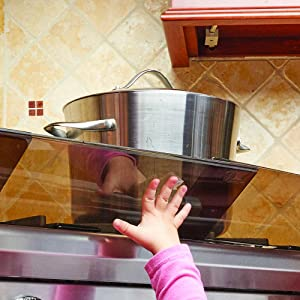 Image: Babies R Us Adjustable Stove Guard | Protects little hands from scalds and burns | Protective stove guard to help protect little hands from reaching up to the stove | Removes easily when no longer needed