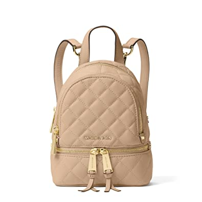 b2d29e588c32c MICHAEL Michael Kors Rhea Extra-Small Quilted Leather Messenger Backpack in  Bisque  Amazon.co.uk  Shoes   Bags