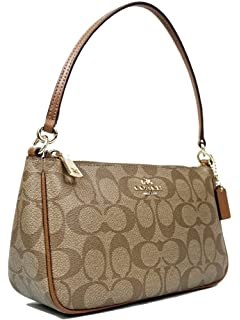 Amazon.com  Coach Womens Top Handle Pouch in Signature Brown Black ... c4ace61378