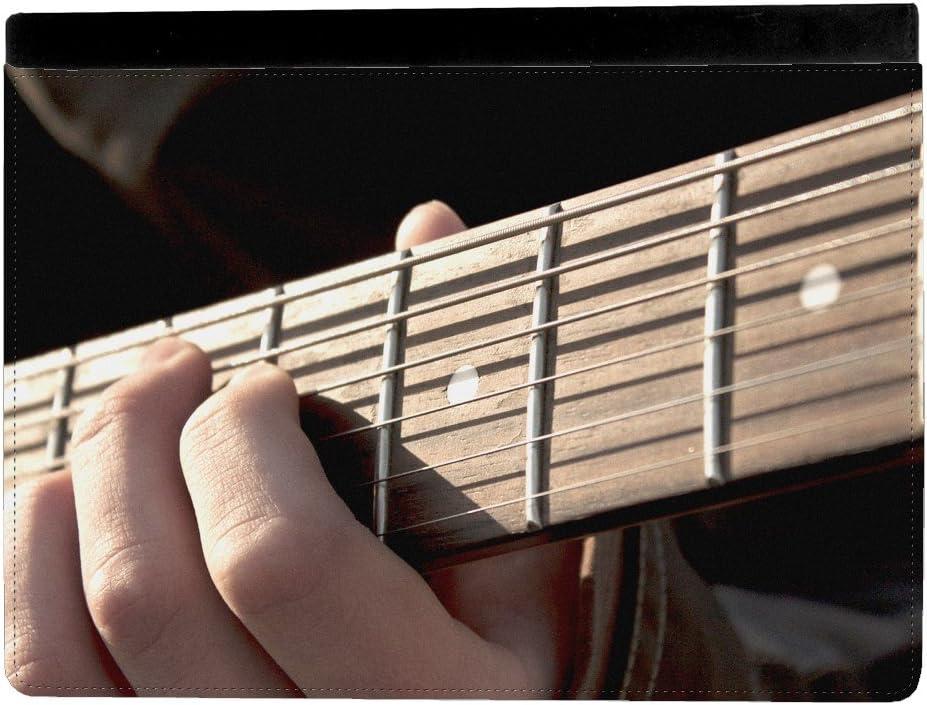 Persona tocando guitarra eléctrica mástil Junta Apple iPad Pro 9.7 ...