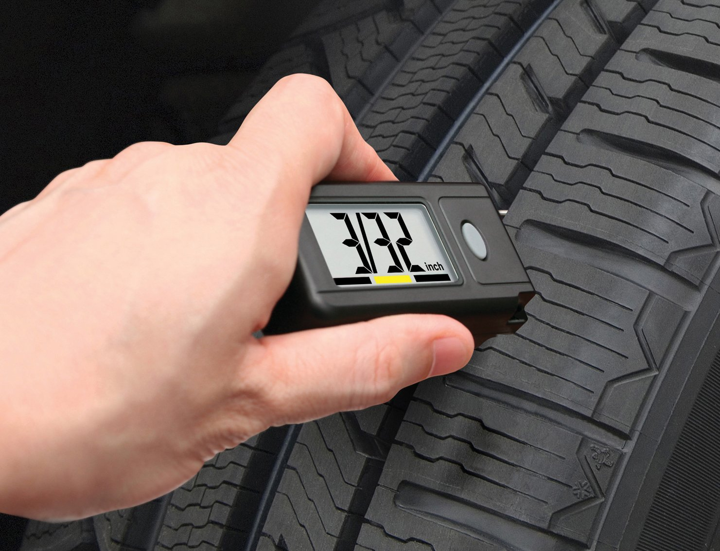 demonstration of checking tire tread depth
