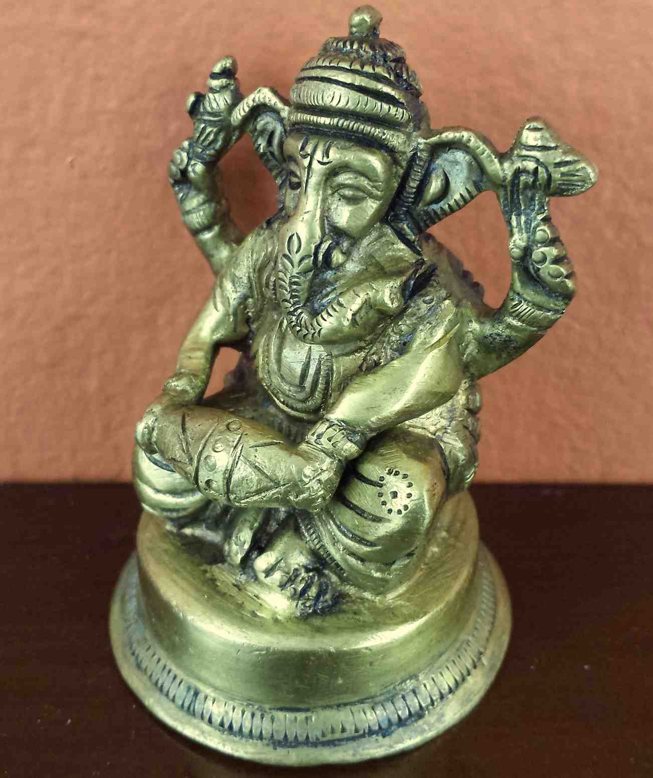 BRASS SEATED GANESHA WITH A DRUM