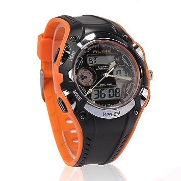 9f9db04f2 Hora Dual estudiantes igualmente impermeable infantil deportes reloj de  pulsera de cuarzo LED con fecha alarma cronómetro (naranja + negro):  Amazon.es: ...