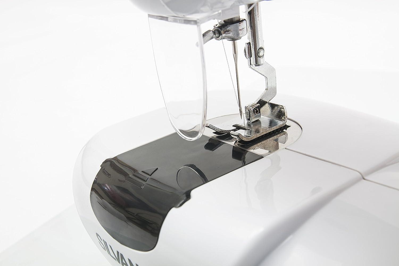 Maquina de coser portatil 7 puntadas corriente y pilas pedal costurera con luz: Amazon.es: Hogar