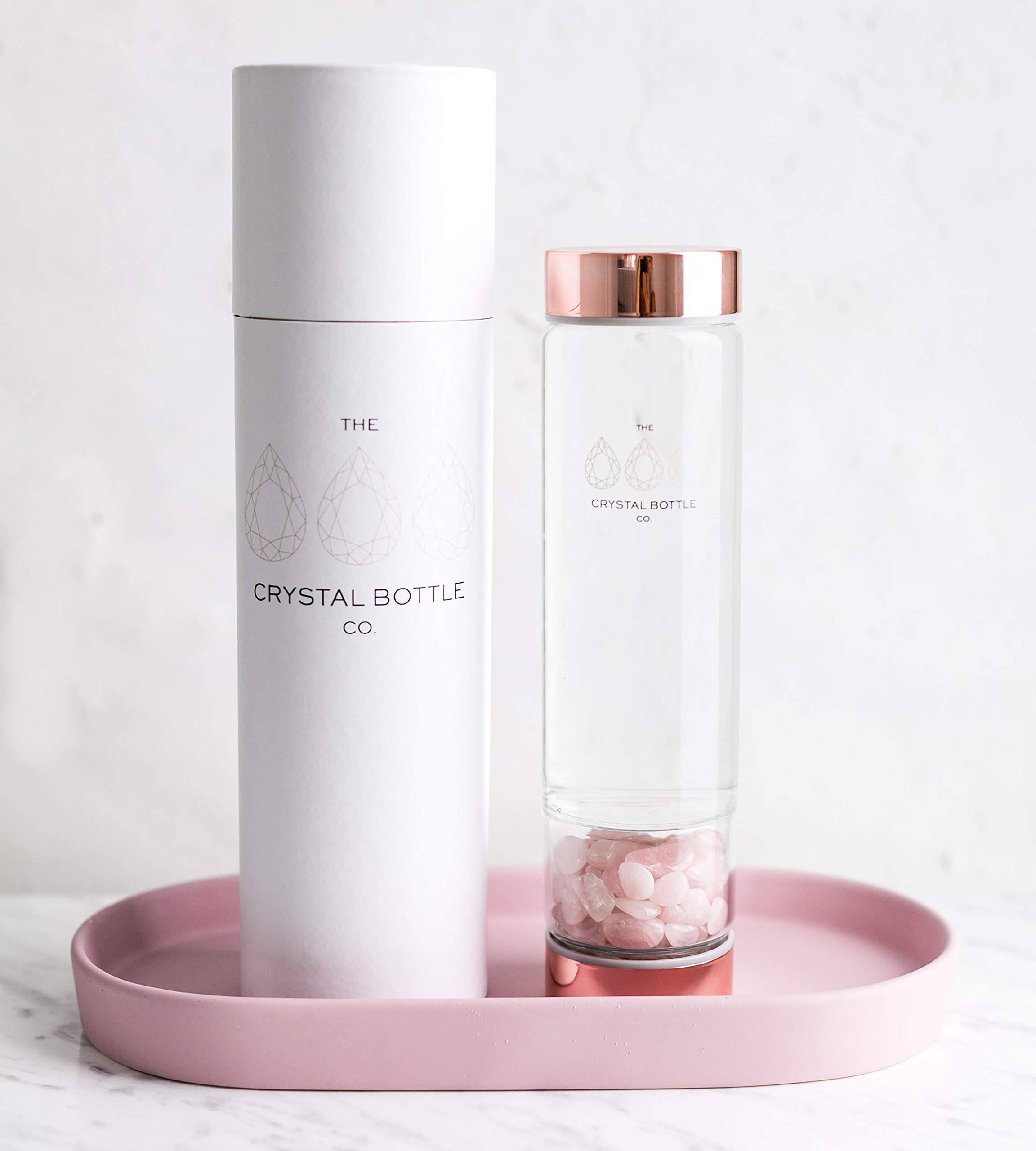 Crystal Elixir Glass Water Bottle - Gemstone Wellness Dispenser with Rose Quartz Crystal Included to Infuse Water for Healing with Rose Gold lids a Great Gift idea for Women and Bridesmaids BPA Free