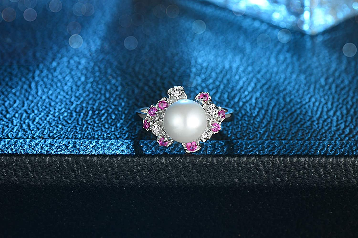 Craft: Plating Artificial Zircon TZSS S925 Sterling Silver fine Color Zircon Flower Pearl Ring Material: S925 Silver Ring Width 2.6mm Weight About 3.6 g. Pearl Inlay Flower Head 12.8 15.6mm