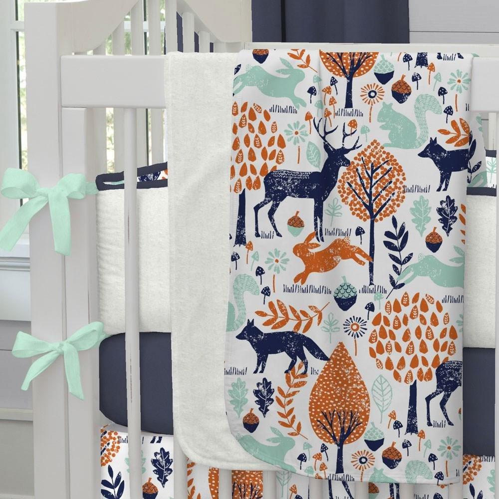 Carousel Designs Navy and Orange Woodland Crib Blanket