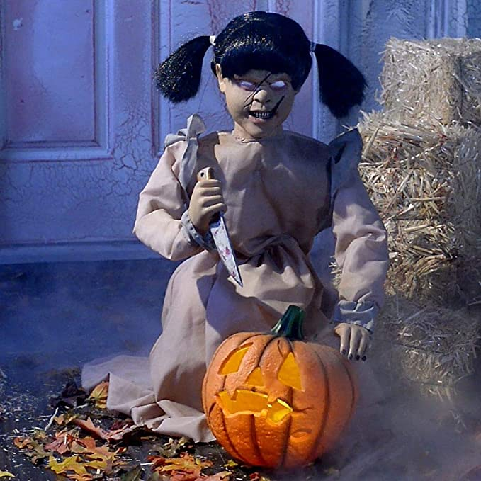 Scary Pumpkin Carver Girl with Knife and Lighted Pumpkin