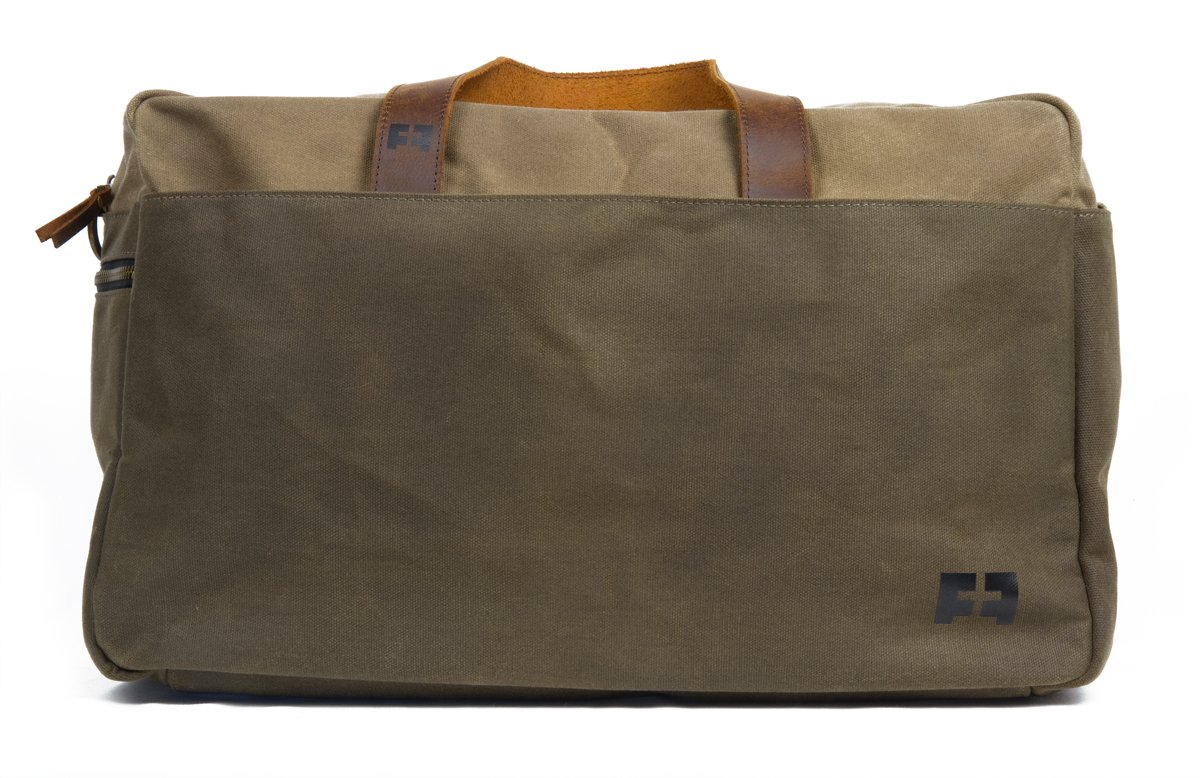 the DUFFEL   Waxed Cotton Canvas Duffel Bag with Leather Handles