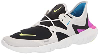 buy popular 58d00 987ab Nike Men s Free RN 5.0 Running Shoes (7.5, White Volt)
