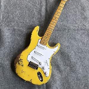 Una guitarra eléctrica antigua, guitarra amarilla: Amazon.es ...