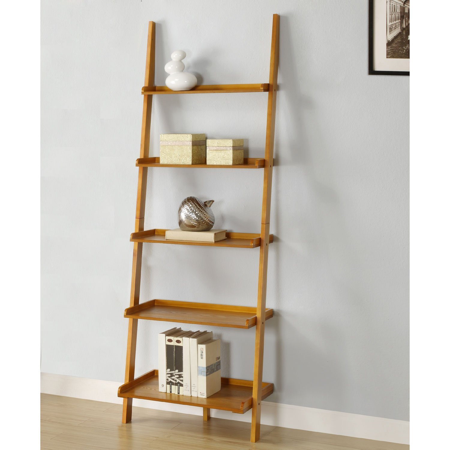 Large leaning shelves. Featuring five shelves, ranging in size from large  to small, this leaning shelf will store and stylize any space.