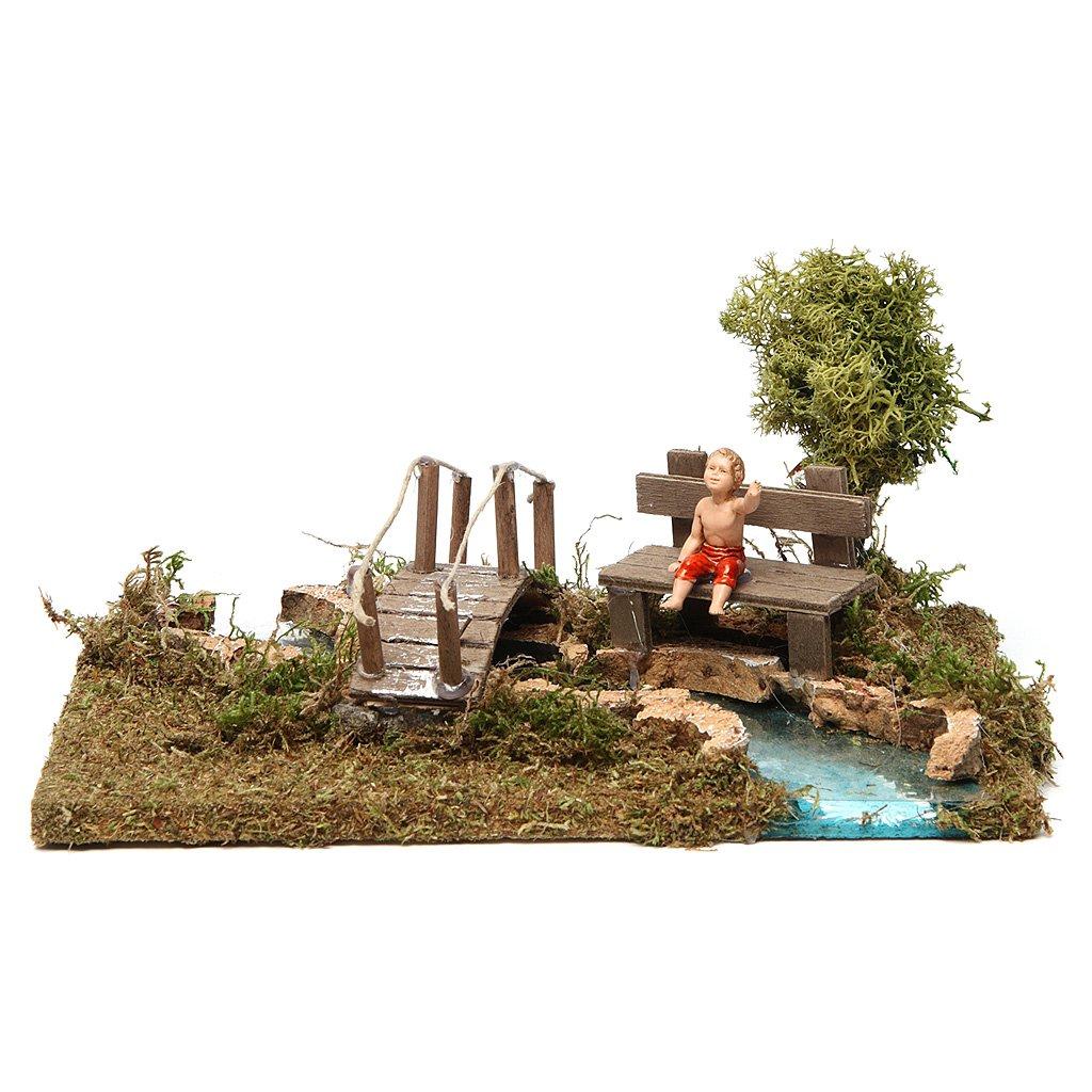 Nativity setting, bridge on river with sitting child