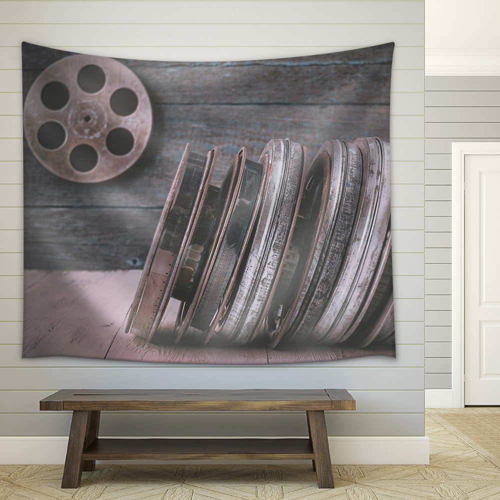 wall26 - Stack of reels of old movies is on a wooden shelf - Fabric Wall Tapestry Home Decor - 68x80 inches