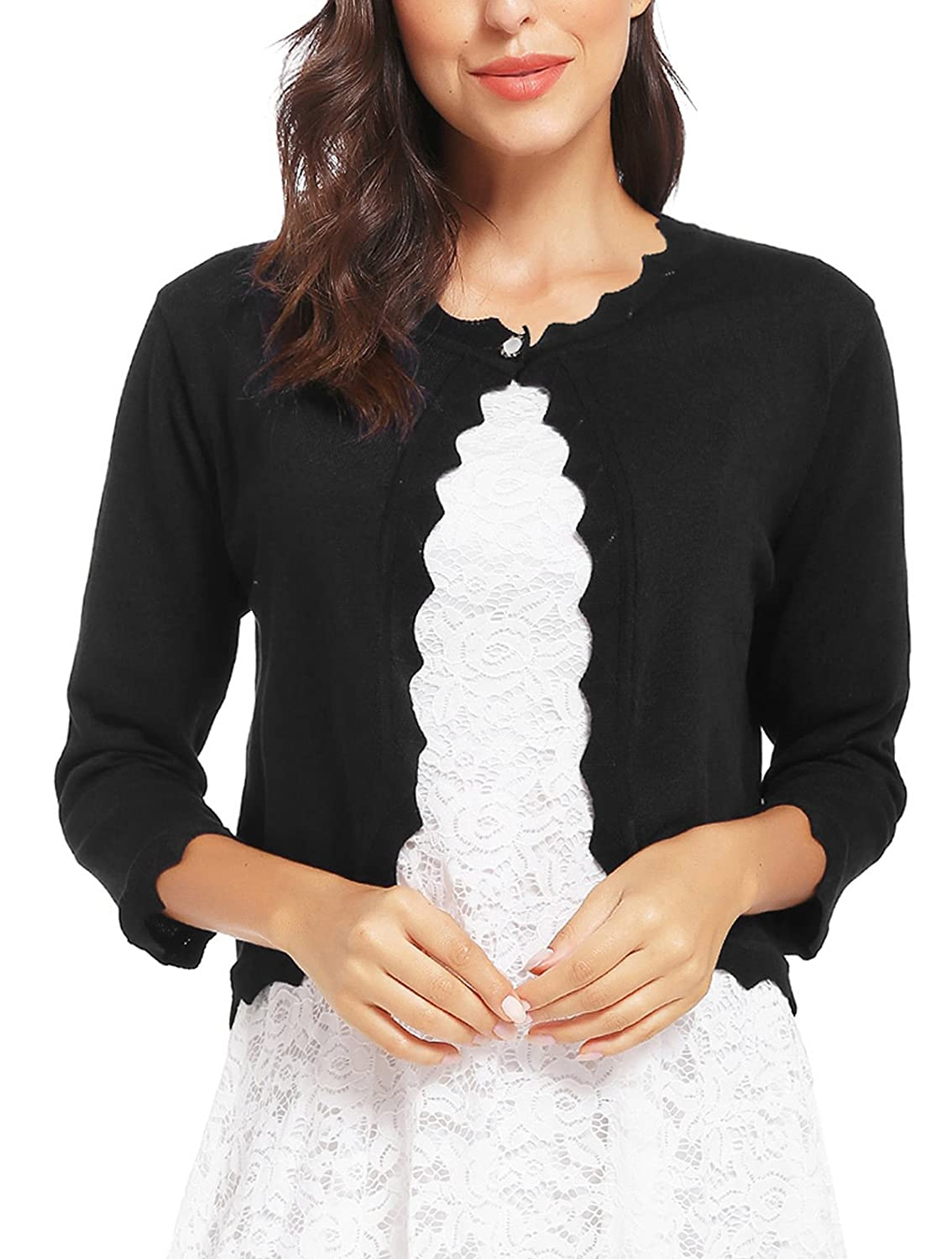 8198a11d89 TOUCH OF STYLE  Add a beautiful dynamic to any outfit with our 3 4 sleeve  bolero shrug. This bolero jacket features a button front closure