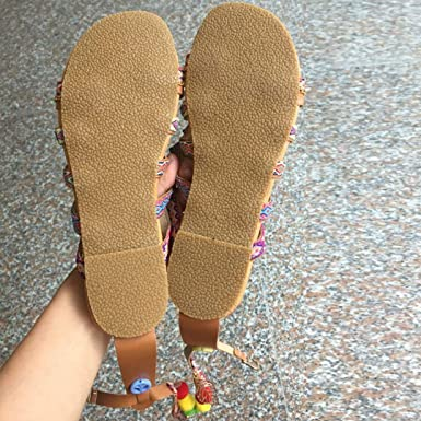 cb07bb47b6b Womens Boho Lace-up Flats Sandals Summer Fashion Cross-Tied Ankle Wrap  Beach Flats Shoes with Pom Poms