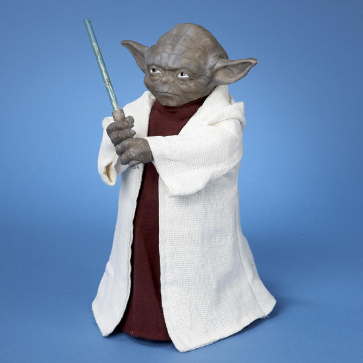 Star Wars Battery Operated Yoda With LED Light Saber and On/Off Button Tree Topper - Uses 3 ''AA'' Batteries (Not Included)