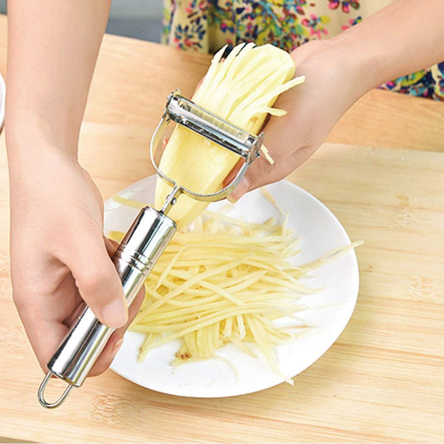 A double panning grater is used to slice potato in the image.