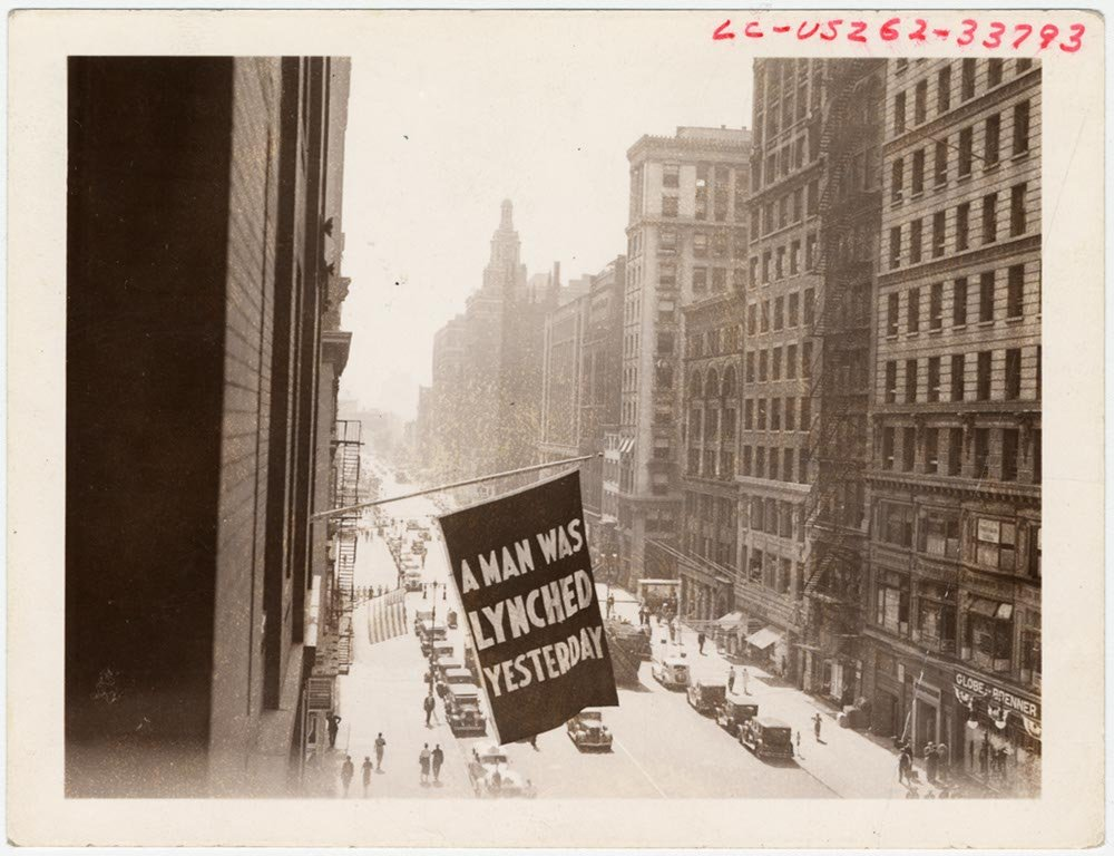 Historic Photos Flag, announcing lynching, flown from the window of the NAACP headquarters on 69 Fifth Ave, New York City