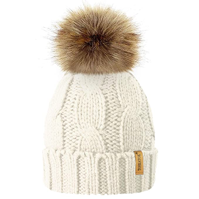 aa3c1e7a514 TOSKATOK® Ladies Chunky Soft Cable Knit hat with Cosy Fleece Liner and  Detachable Faux Fur Pompom-Cream  Amazon.co.uk  Clothing