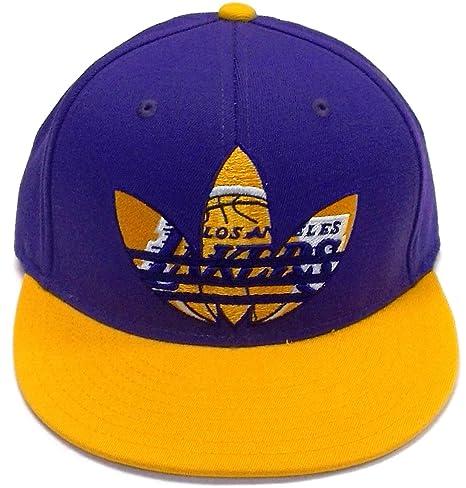 Amazon.com   Los Angeles Lakers Flat Bill Fitted Flexfit Hat by ... 14ddb291b47