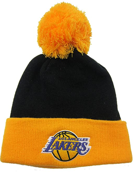 Amazon.com   Los Angeles Lakers Black   Yellow Cuffed Pom Knit Cap ... c0a9822d604