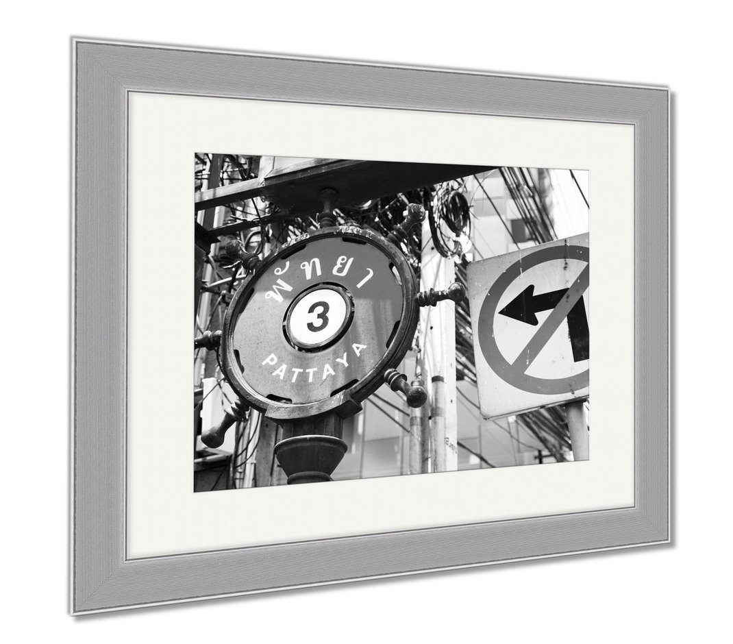 Ashley Framed Prints Street Sign Pattaya 3 In English And Thai Next To A No Left Turn Sign, Wall Art Home Decoration, Black/White, 30x35 (frame size), Silver Frame, AG5892511