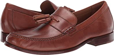 cebf3aaa88f Cole Haan Men s Pinch Handsewn Tassel Loafer British Tan Handstain Dark  Natural 7 D US
