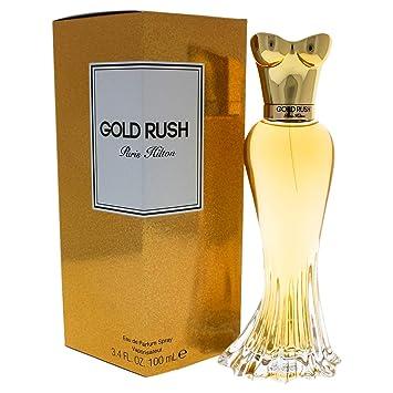 Amazoncom Paris Hilton Gold Rush Eau De Parfum Spray 34 Oz 100