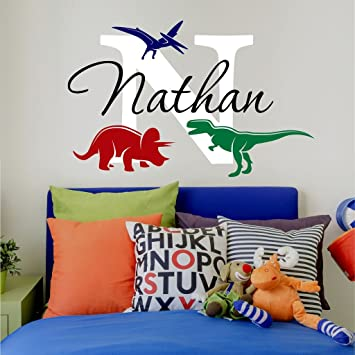 Nursery boys name and initial dinosaurs personalized name wall decal 20 w by 13