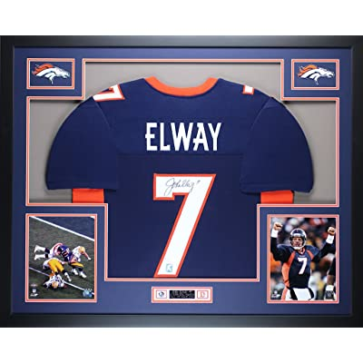 81962946fc2 John Elway Autographed Blue Broncos Jersey - Beautifully Matted and Framed  - Hand Signed By John Elway and Certified Authentic by JSA COA - Includes  ...