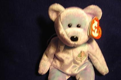 30af4305dac Amazon.com  Qiyun Ty Beanie Baby Issy Maui Bear Donated for Cancer ...