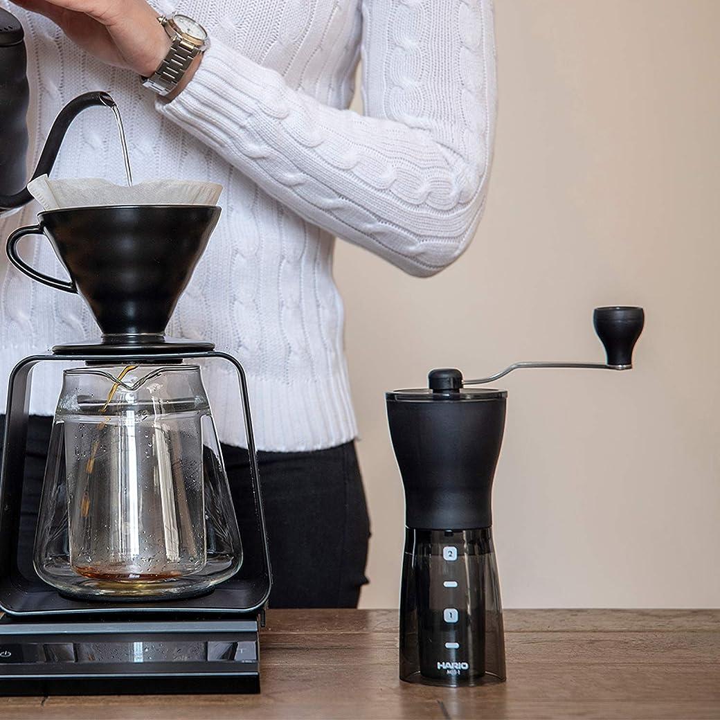Molinillo de café manual compacto y ajustable con rebabas HARIO