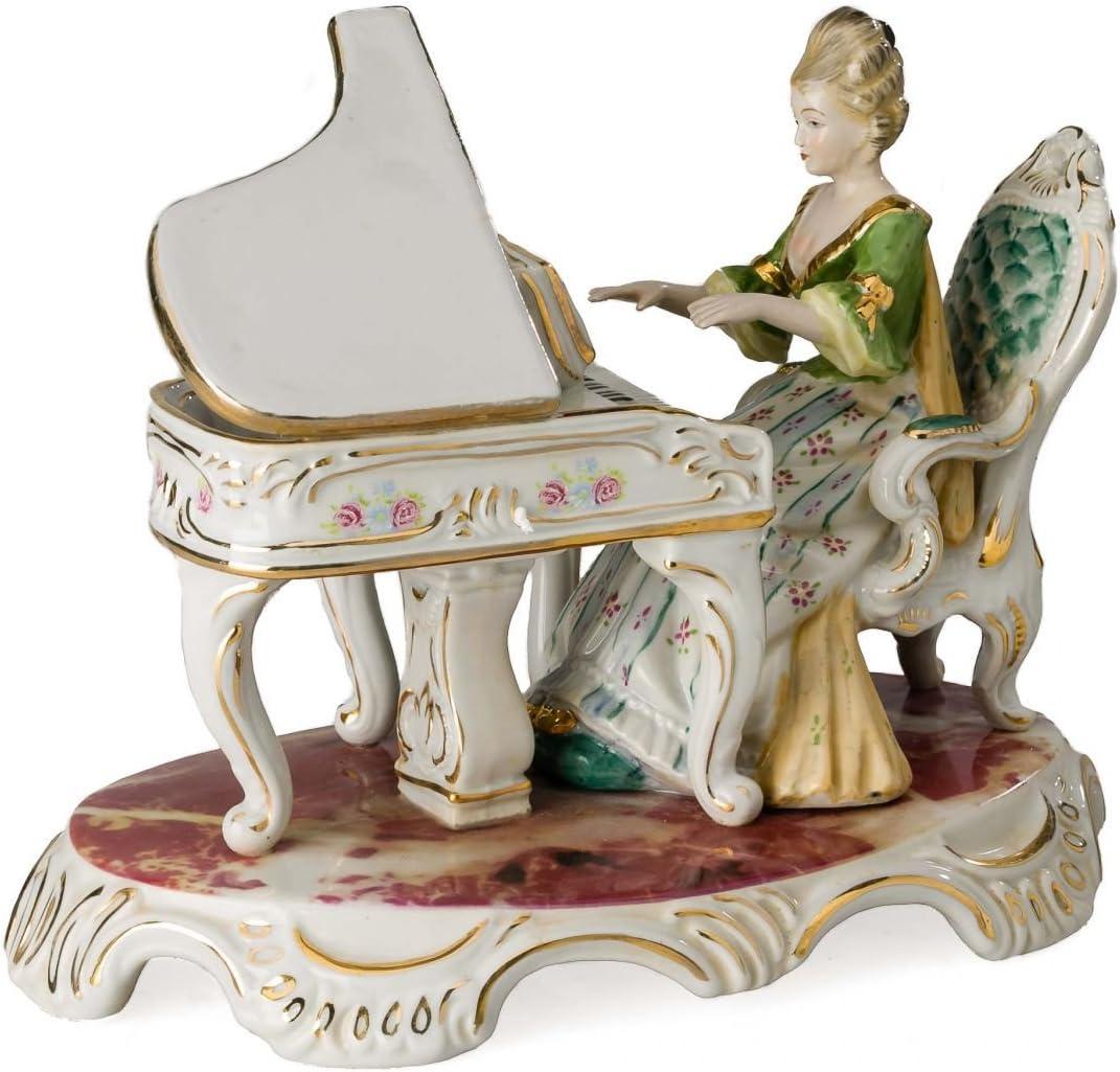 Statuette de femme au piano style antique porcelaine