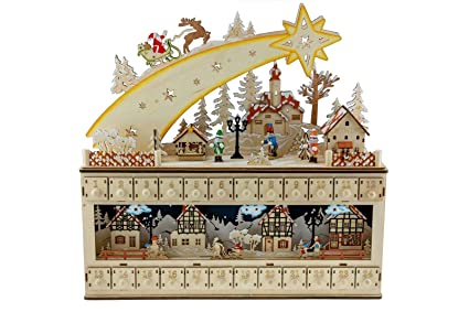 amazon com clever creations shooting star snowy village 24 day