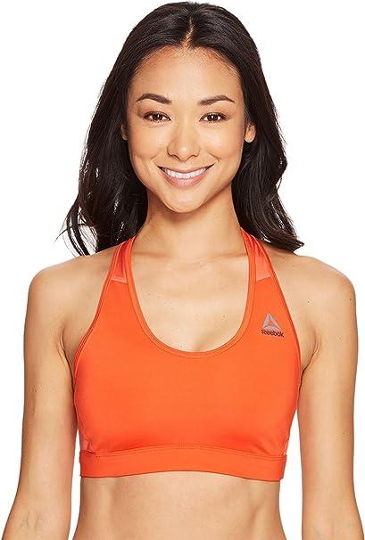 748abc4f07715 Reebok Women s Workout Ready Stacked Logo Medium Support Bra Carotene Bra